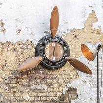 Horloge forme hélice 110x16x132 cm en métal marron et noir